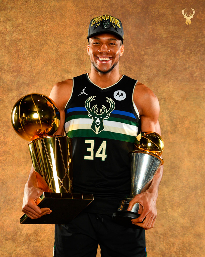 Giannis Antetokounmpo with the Larry O'Brien trophy and the MVP Finals. Source: Milwaukee Bucks.